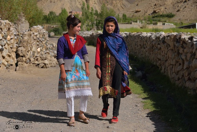 These two young girls dressed up to go to Zood Khun library. Chapursan Valley Travel Guide, Lost with purpose, Alex Reynolds